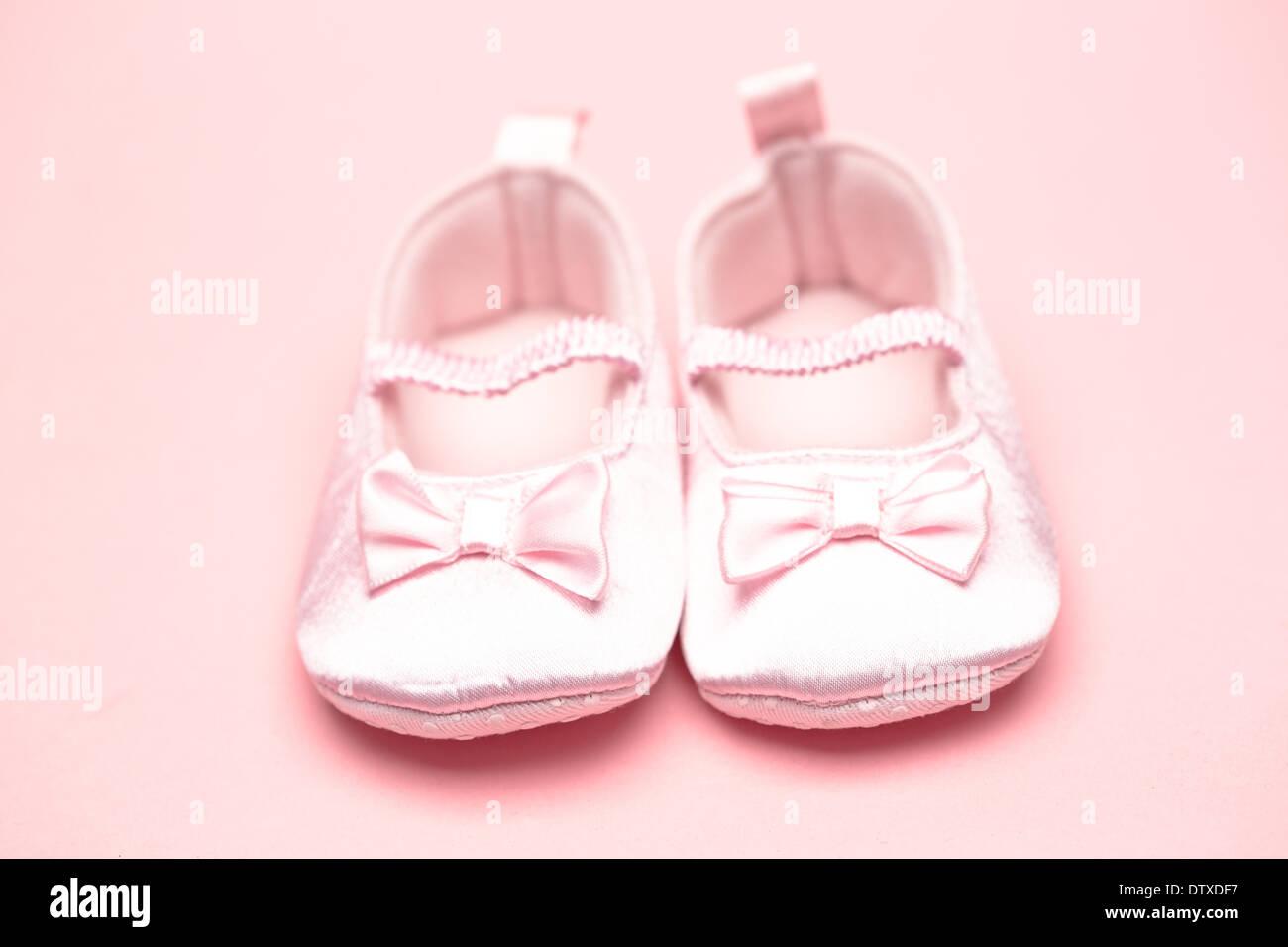 Baby girls pink booties - Stock Image
