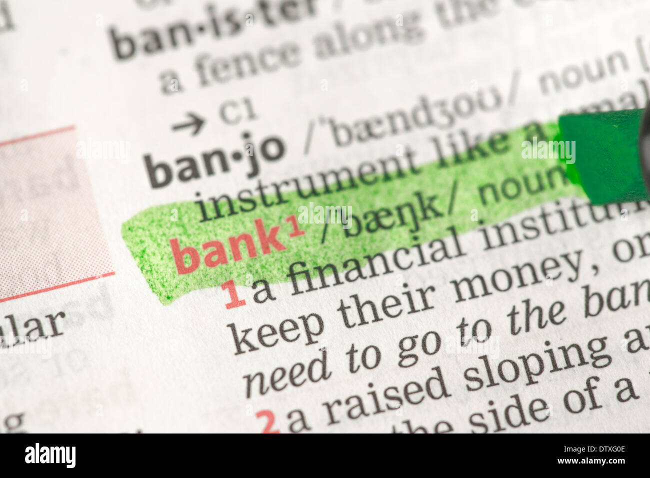 Bank definition highlighted in green Stock Photo: 66966158 - Alamy