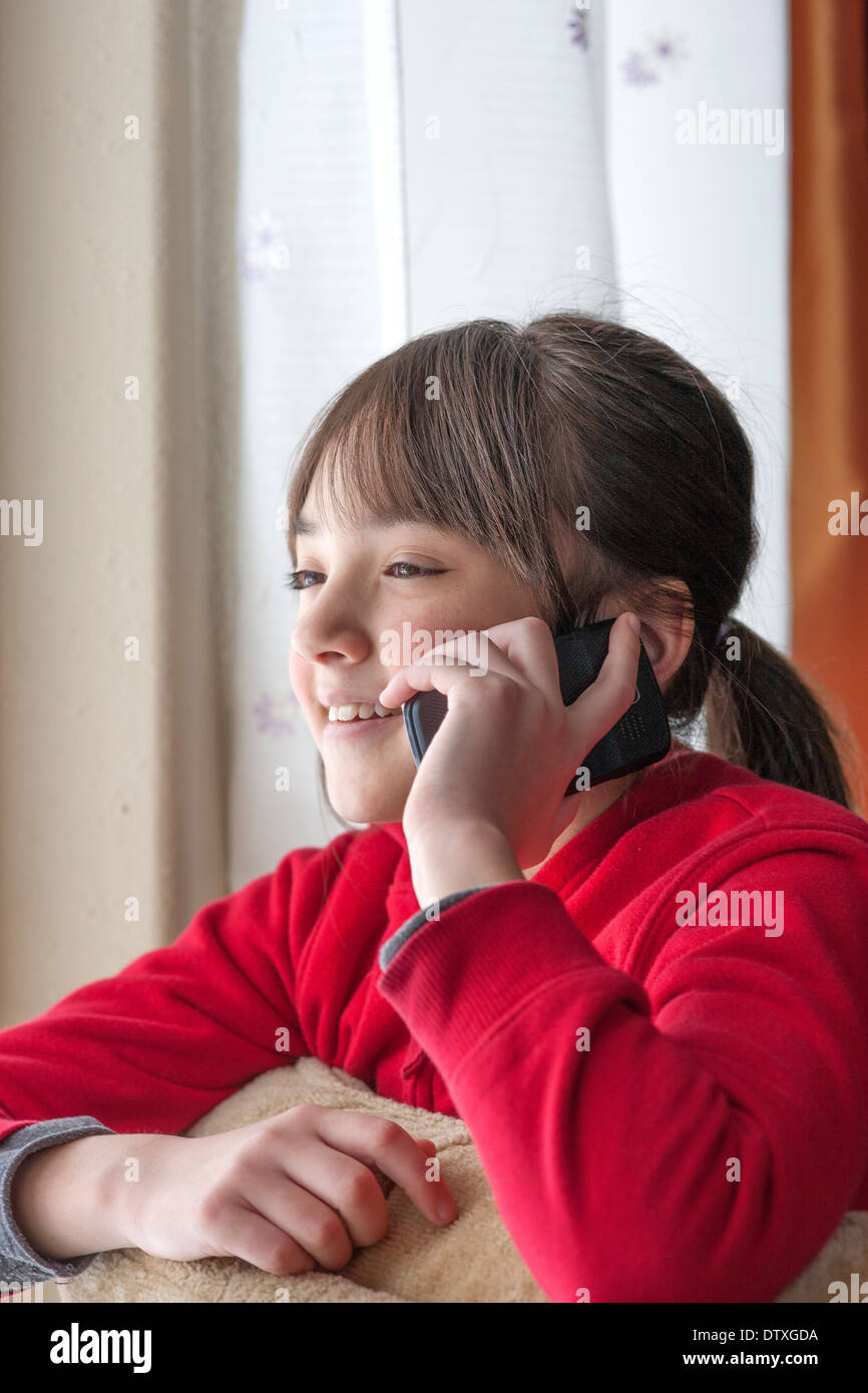 Young girl on cellphone. - Stock Image