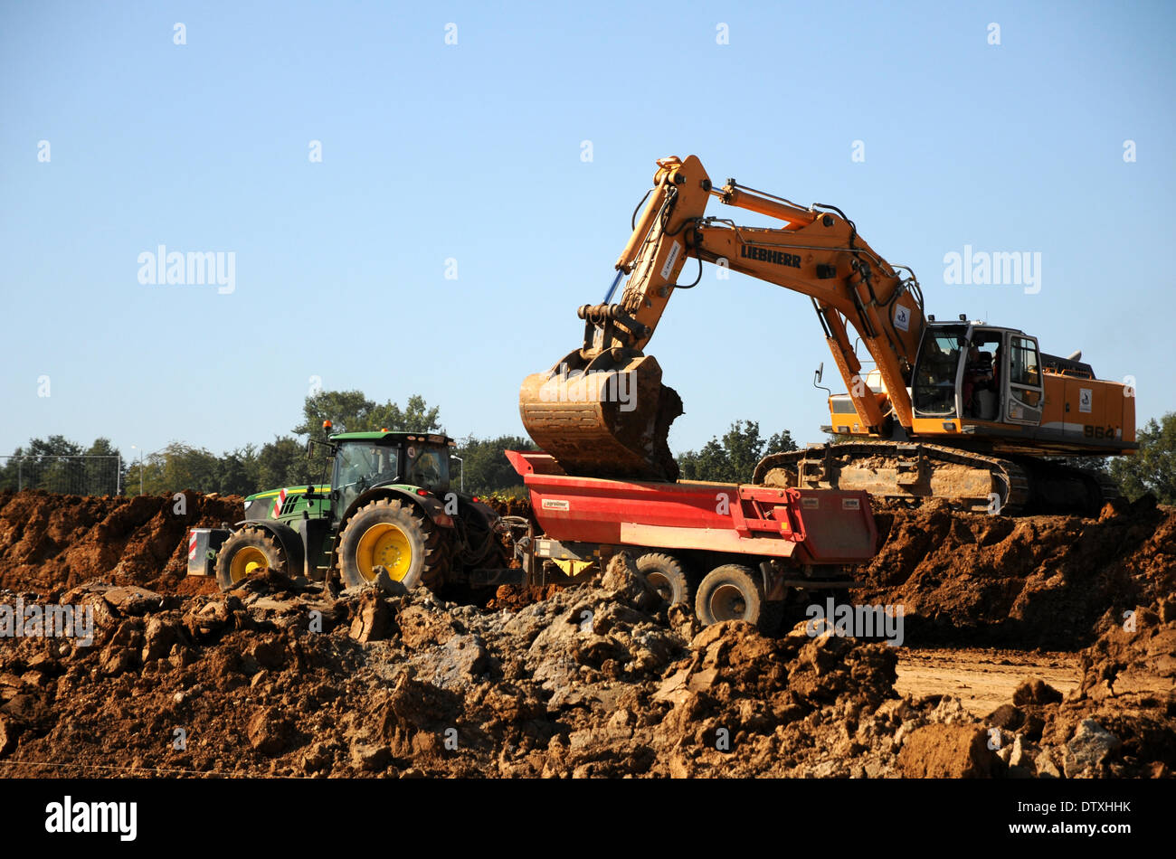 Excavating and transporting soil - Stock Image