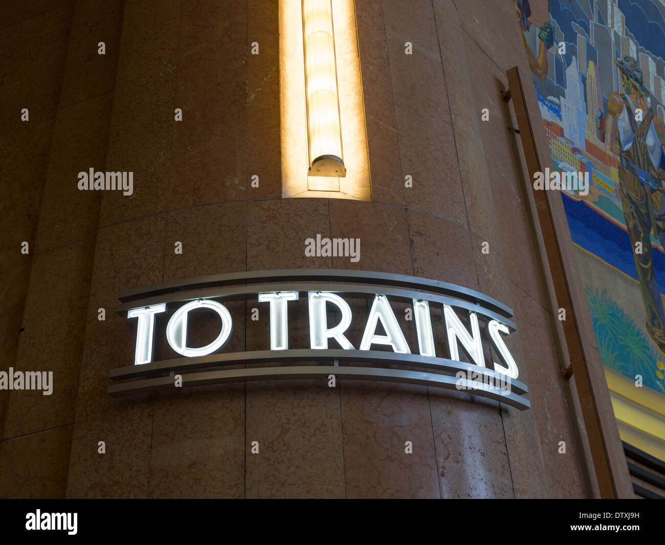 Neon To Trains sign. An old neon sign, a relic from Union Terminal's original purpose decorates one of the museum's - Stock Image