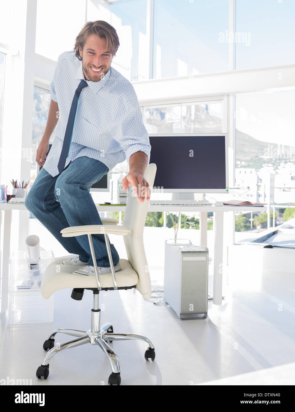 Man surfing his office chair - Stock Image