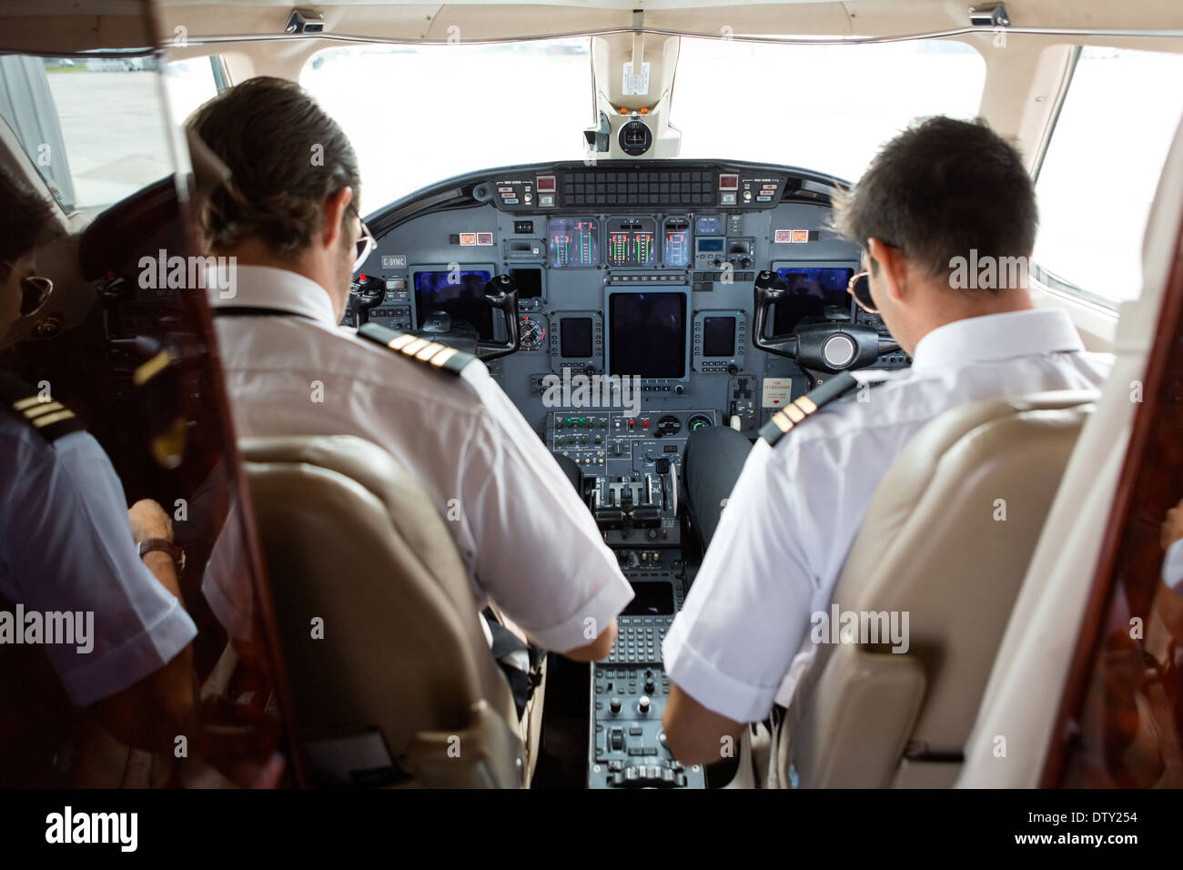 Pilot And Copilot In Cockpit - Stock Image