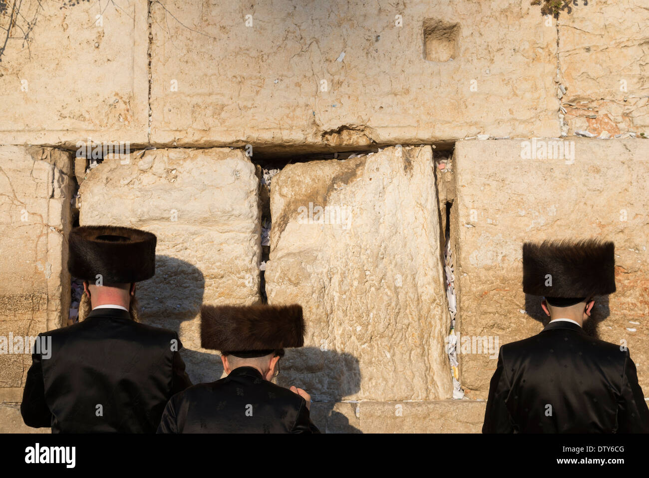 Three orthodox Jews with Shtreimel hats praying at the Western Wall.Jerusalem Old City. Israel. - Stock Image