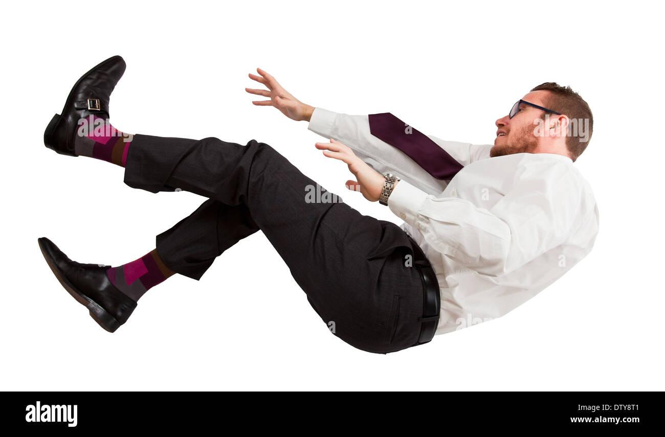 caucasian businessman in falling pose - Stock Image