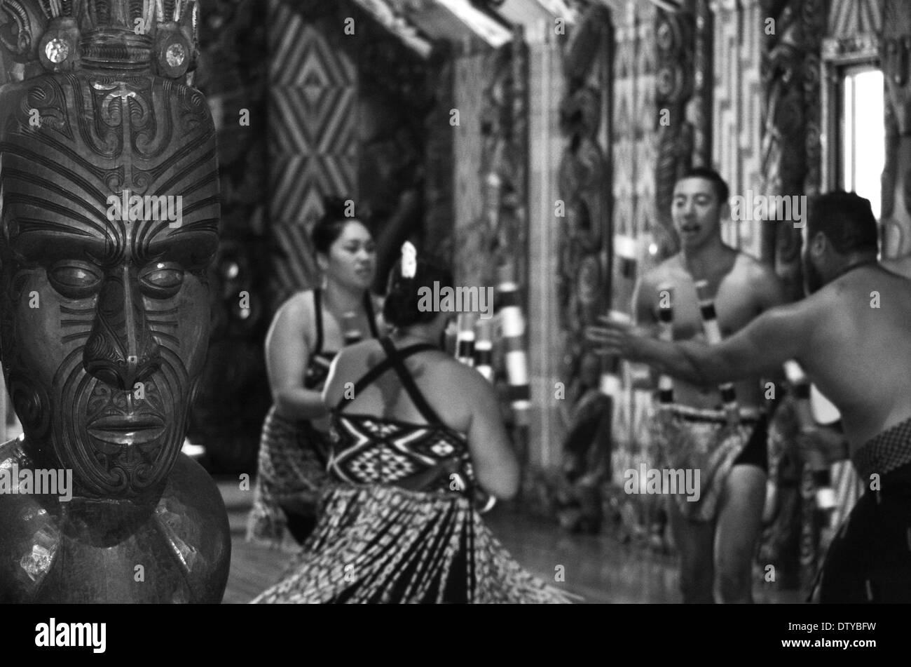 Maori people sing and dance during Waitangi Day in Waitangi, Northland, New Zealand (BW) - Stock Image