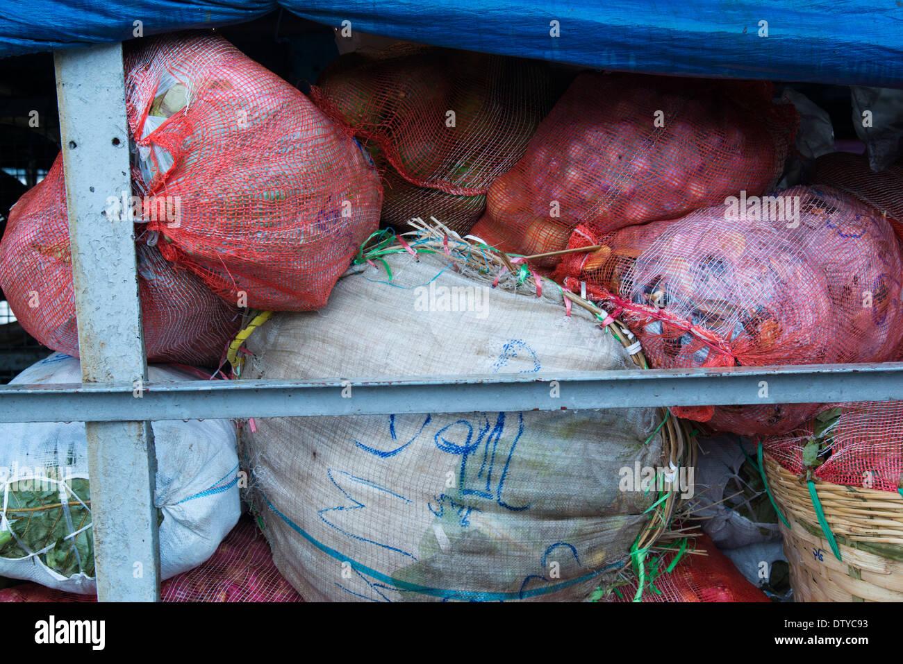 Bags of vegetable on a freat boat. Yangon. Myanmar (Burma). Stock Photo