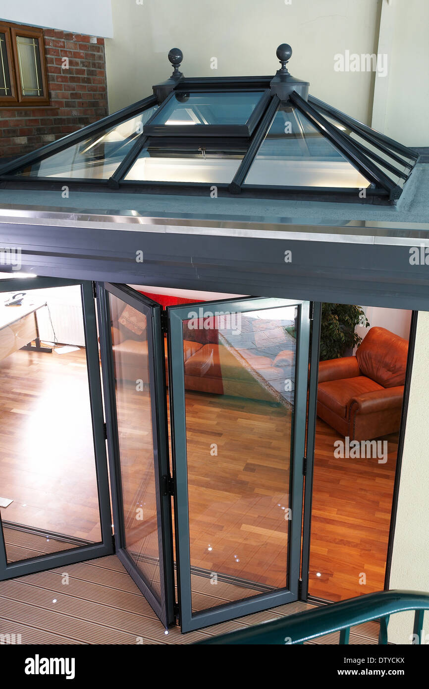 A series of images showing folding doors and skylight on an orangery ...