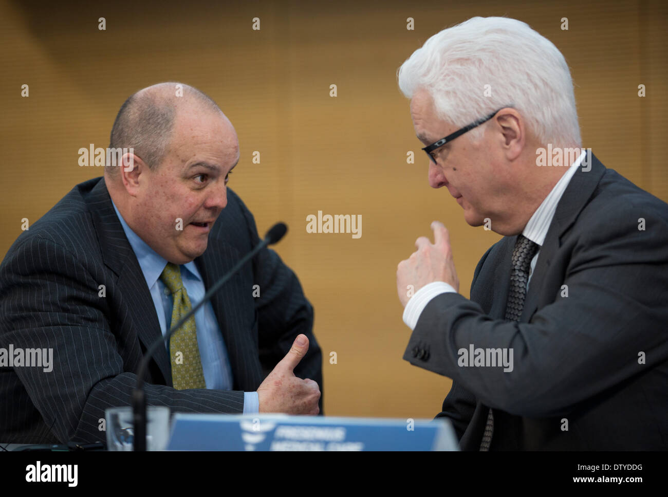 Bad Homburg, Germany. 25th Feb, 2014. CEO of Fresenius Medical Care (FMC), Rice Powell, and CFO Michael Brosnan talk before the joint annual results press conference of Fresenius SE and FMC in Bad Homburg, Germany, 25 February 2014. Medical company Fresenius achieved the best annual result in the company's history in 2013. Profits rose by twelve percent to 1.05 billion euros. Photo: FRANK RUMPENHORST/DPA/Alamy Live News - Stock Image