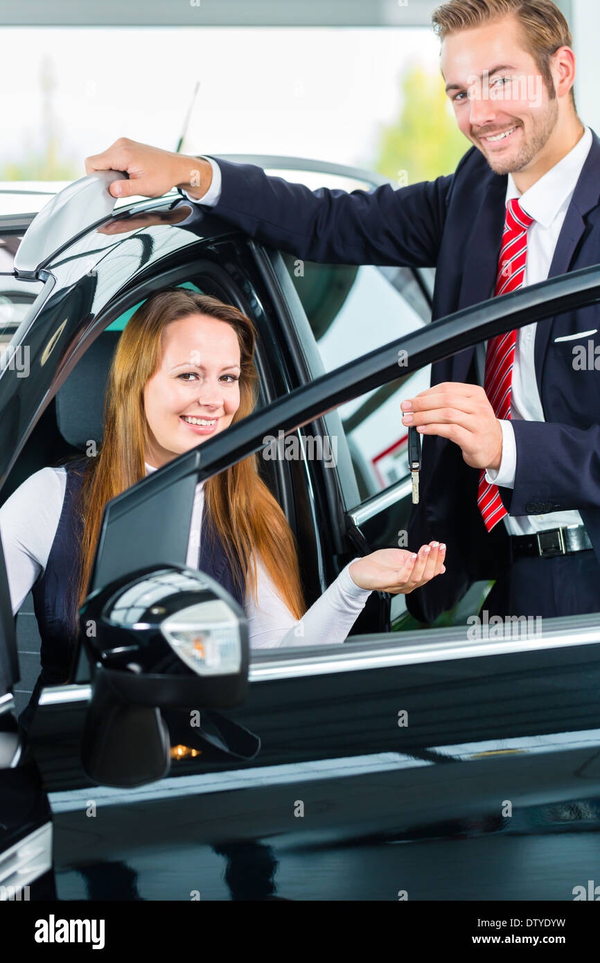 Seller Or Car Salesman And Female Client Or Customer In Car Stock