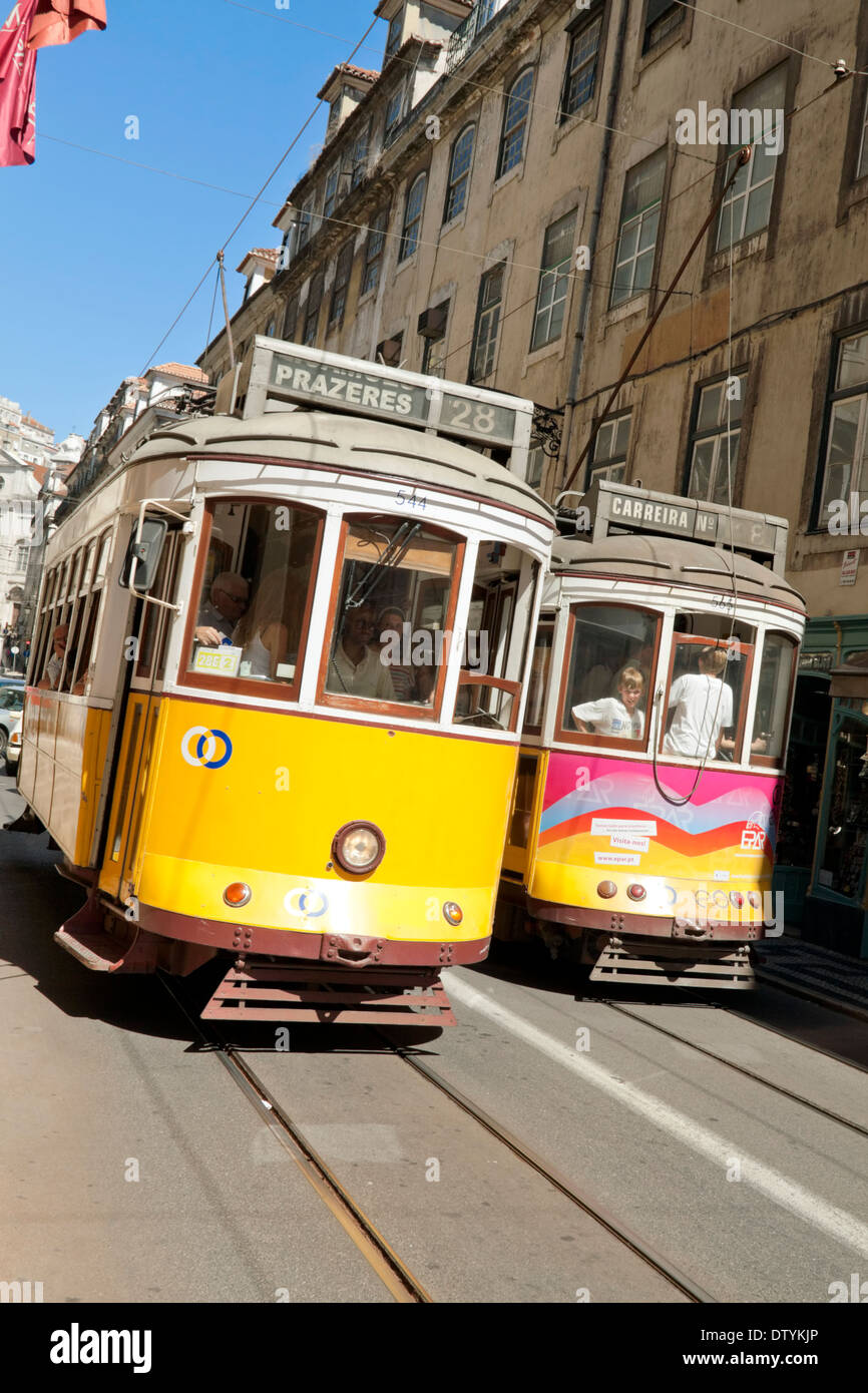 Famous yellow vintage streetcars or trams in Lisbon, Baixa district,  Portugal. - Stock Image