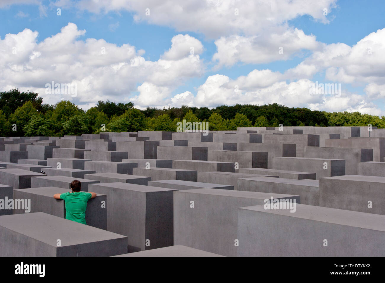 A visitor in the Memorial to the Murdered Jews of Europe (also known as the Holocaust Memorial), in Berlin, Germany. - Stock Image