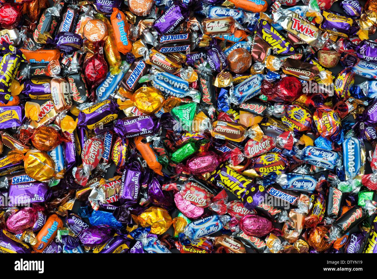Celebration Chocolates. Assorted Mini Chocolates Pattern. Chocolate sweet wrappers pattern - Stock Image