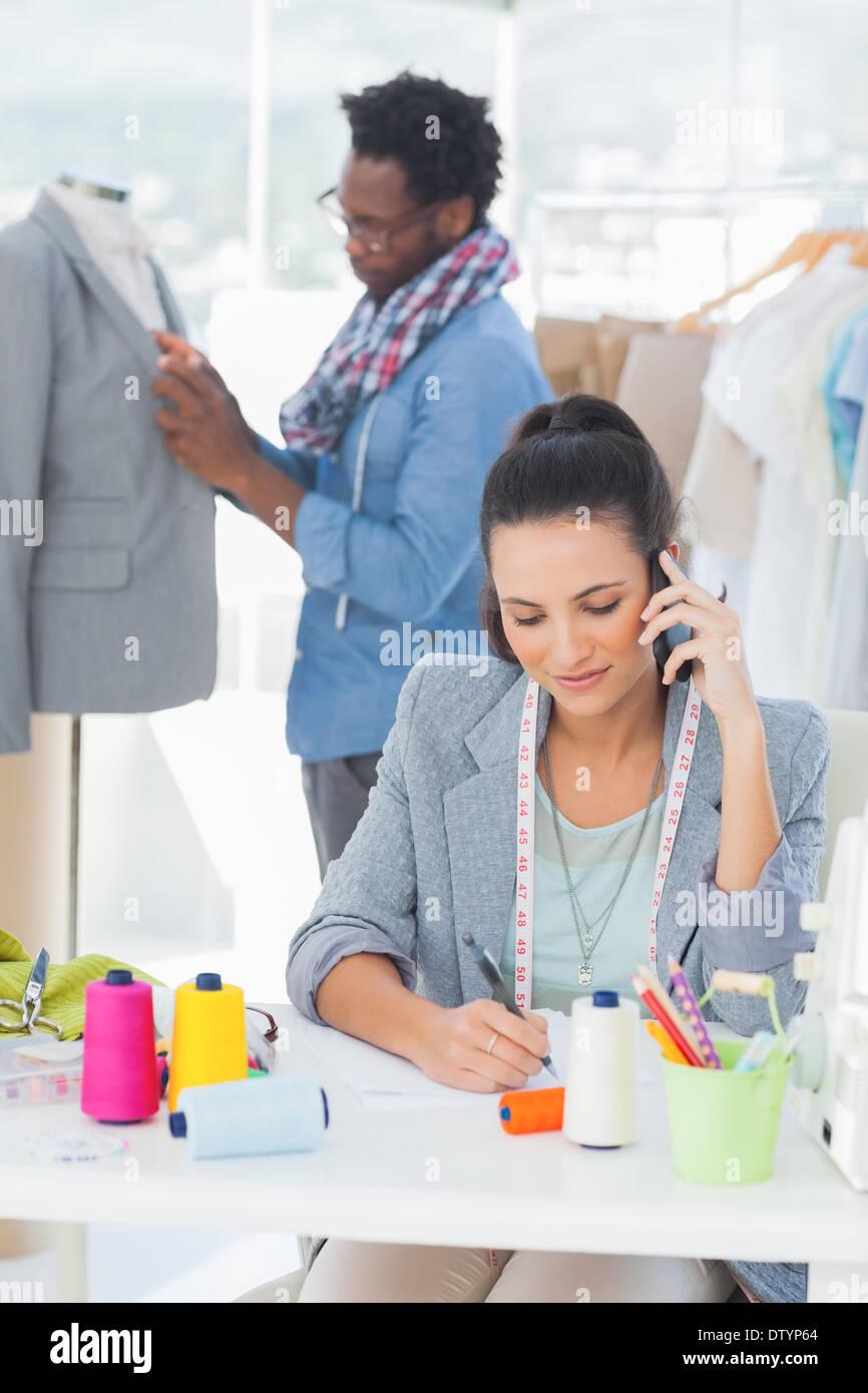 Attractive fashion designer calling - Stock Image