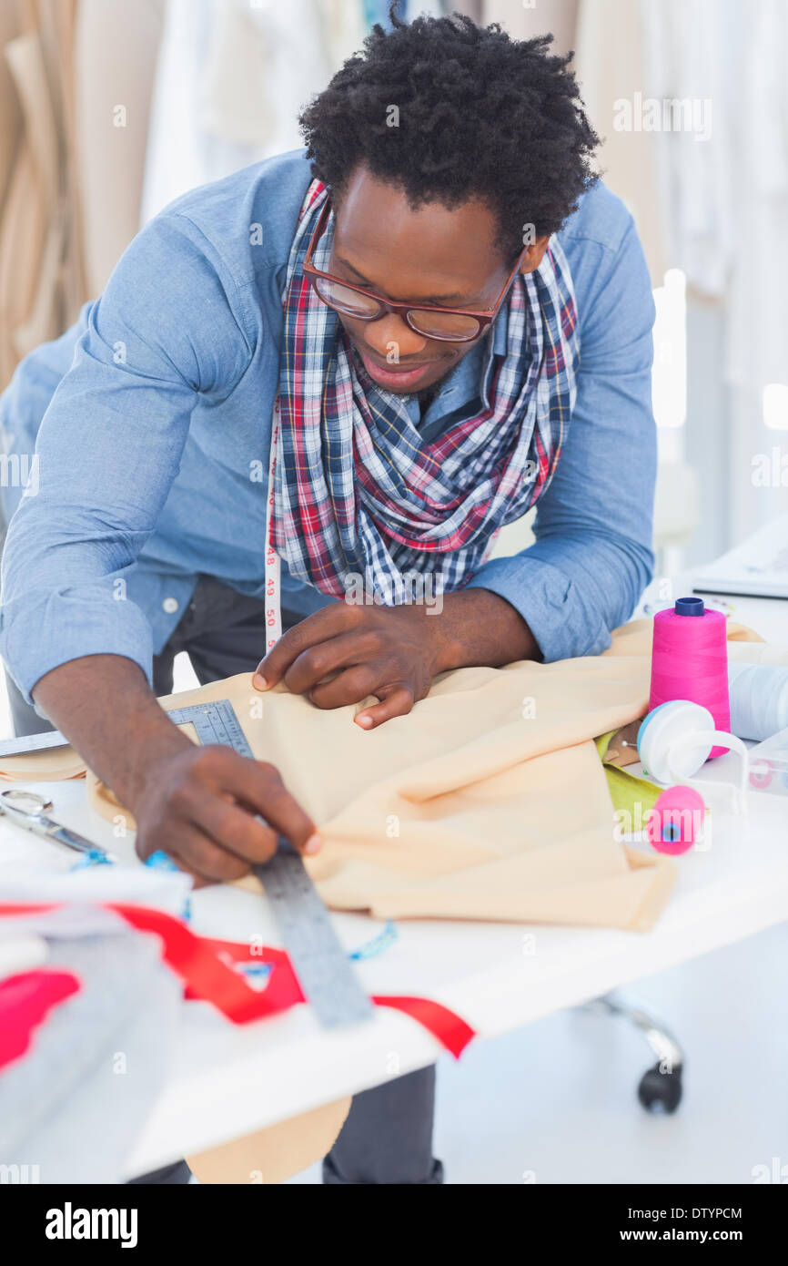 Fashion designer measuring clothes - Stock Image