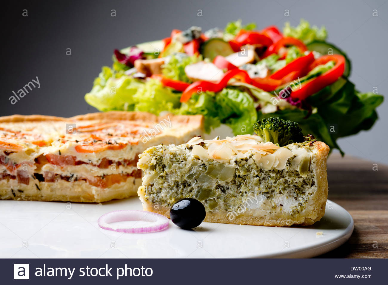 Broccoli And Tomato Tarts Served On White Plate With A Fresh Chicken
