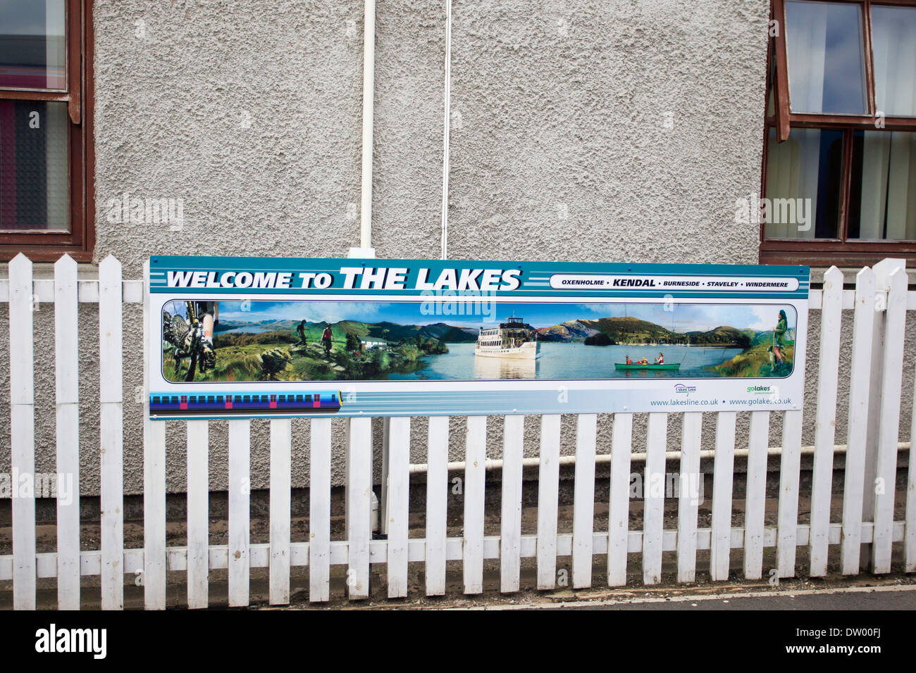 Welcome to the Lakes Kendal railway station sign - Stock Image