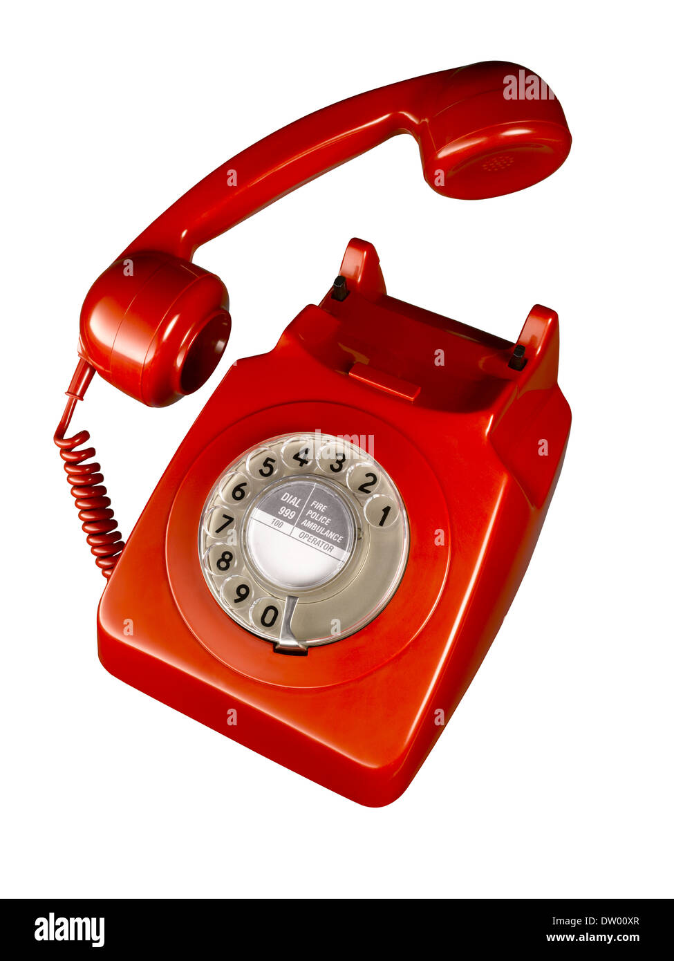 A cut out shot of a old fashioned red telephone. Stock Photo