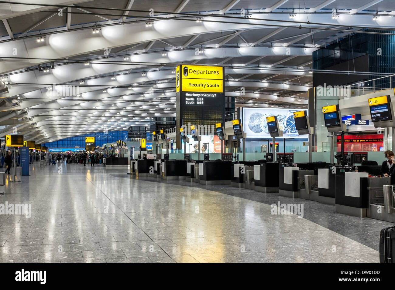 Modern architecture, elegant curved roof and check-in area in departure hall of Terminal 5 T5, Heathrow Airport, - Stock Image
