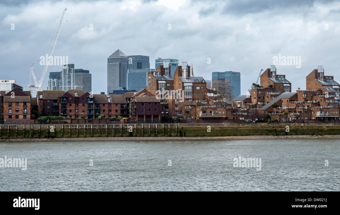 View of Canary Wharf Financial district, Tower Hamlets houses and river Thames from Greenwich, London, UK - Stock Image