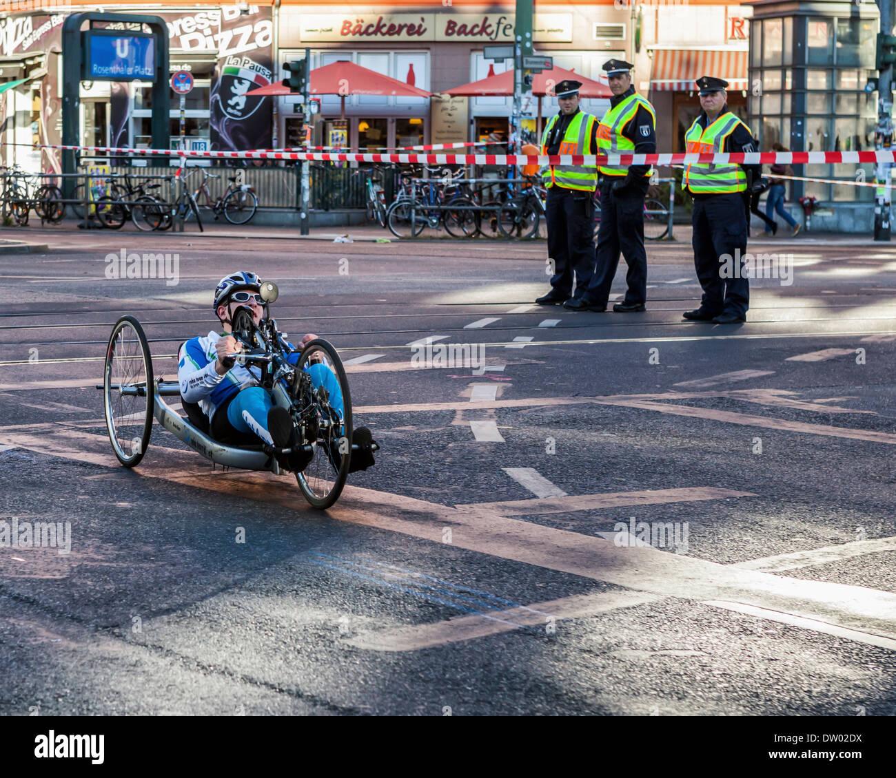 Disabled handbike competitor in 40th 42 kilometre Berlin marathon 2013 - Rosenthalerplatz, Mitte, Berlin - Stock Image