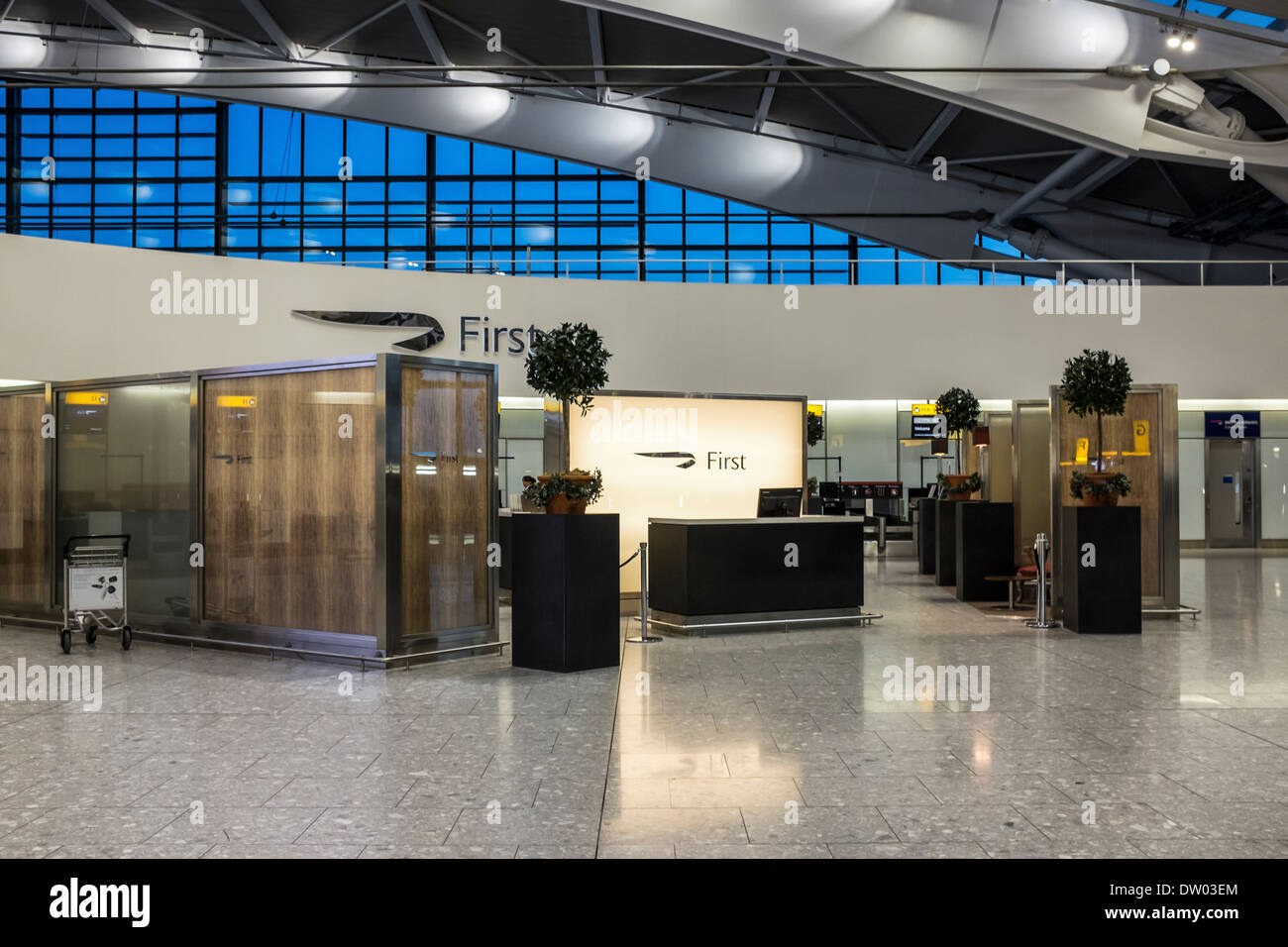 Terminal 5 T5 elegant check-in area for First Class passengers at Heathrow Airport, London, UK - Stock Image