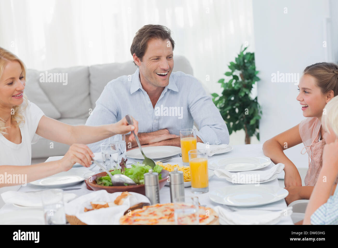 Family around the dinner table - Stock Image