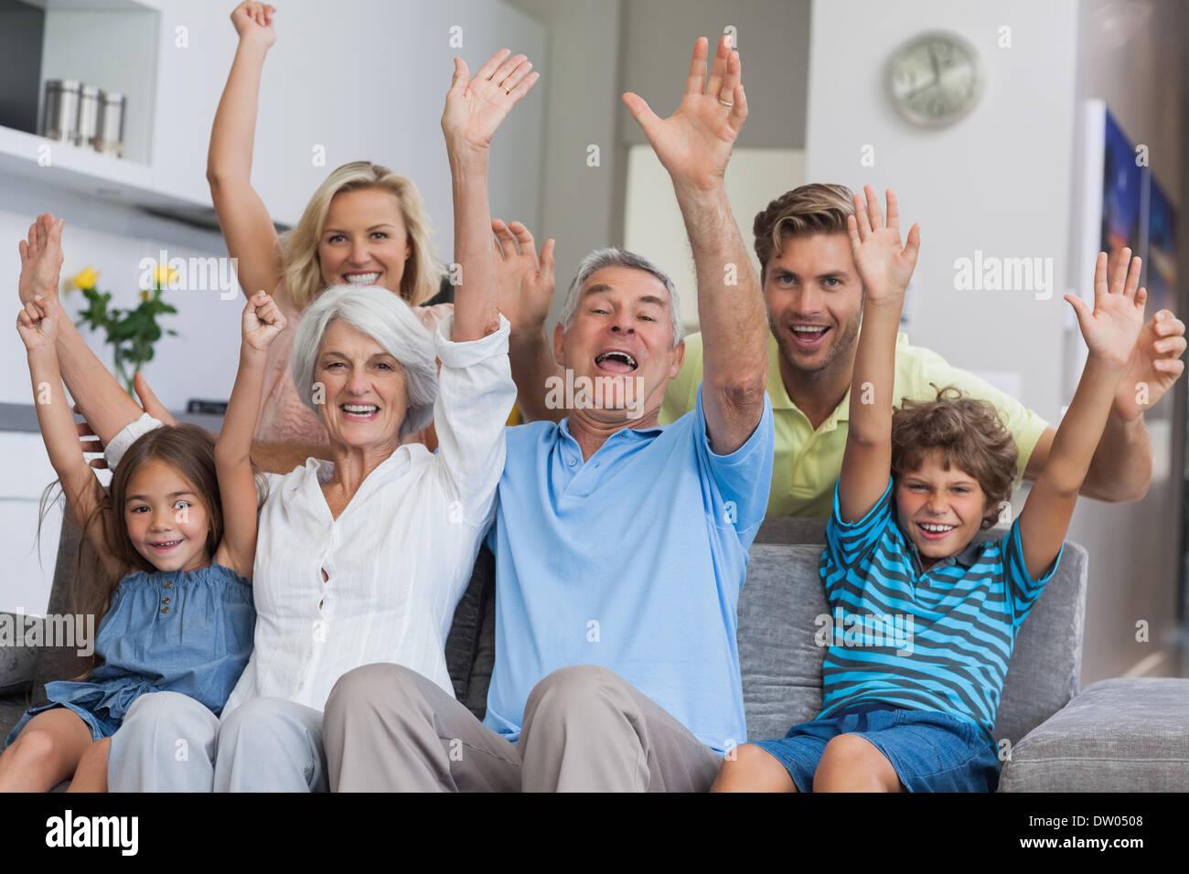 Multi-generation family raising their arms Stock Photo