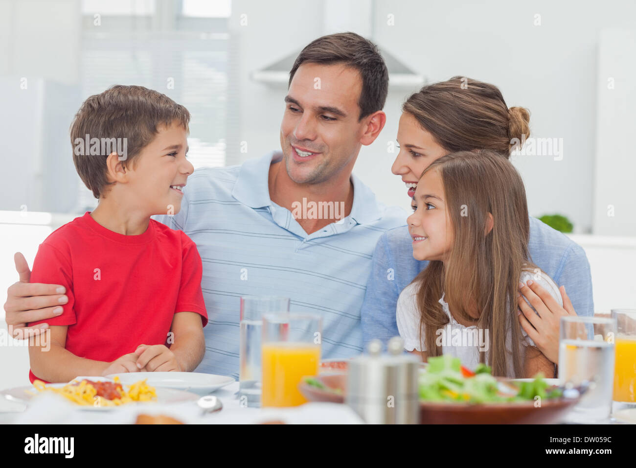 Happy family during the dinner - Stock Image