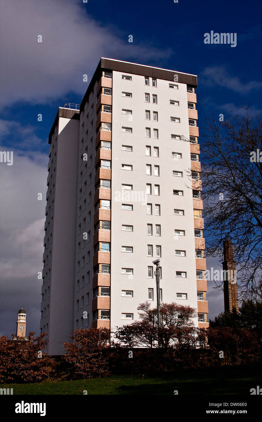 A 1960`s Lochee Multi-Storey building situated between the 1800`s of Cox`s Stack Clock and Chimney jute mill in Dundee, UK - Stock Image