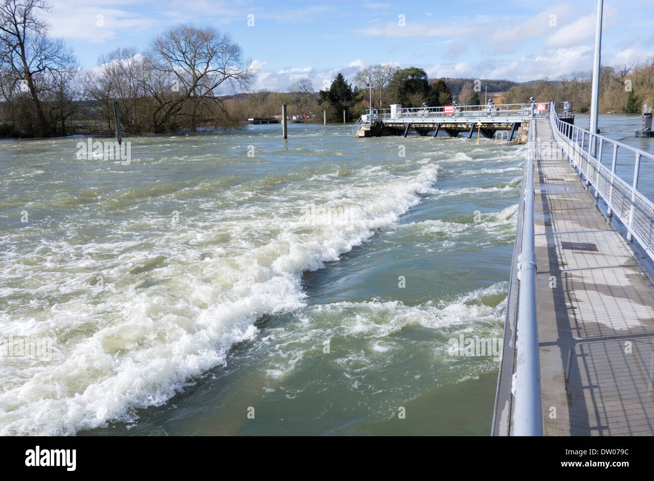 England, Berkshire. River Thames in flood at Hambleden lock weir Stock Photo