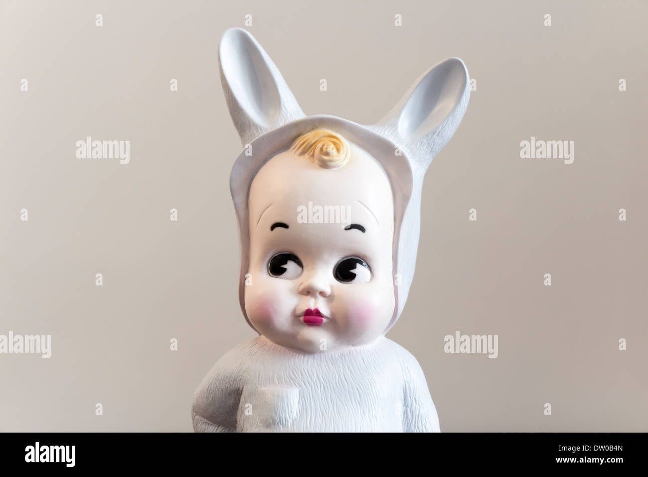 Cute toy of a baby with bunny disguise - Stock Image