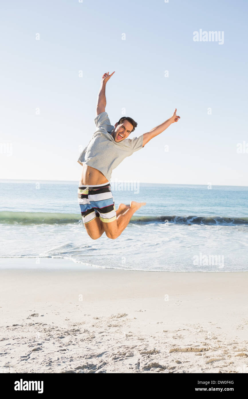 Energetic handsome man jumping - Stock Image