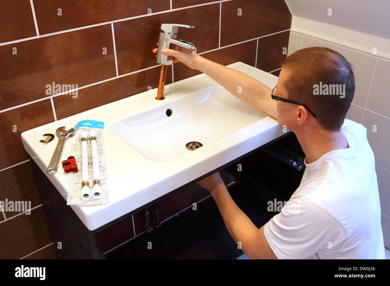 DIY Plumber Fitting A Tap During A New Bathroom Renovation Stock - Plumber bathroom renovation