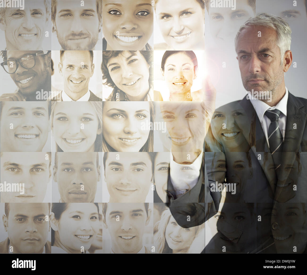 Serious businessman choosing future employees - Stock Image