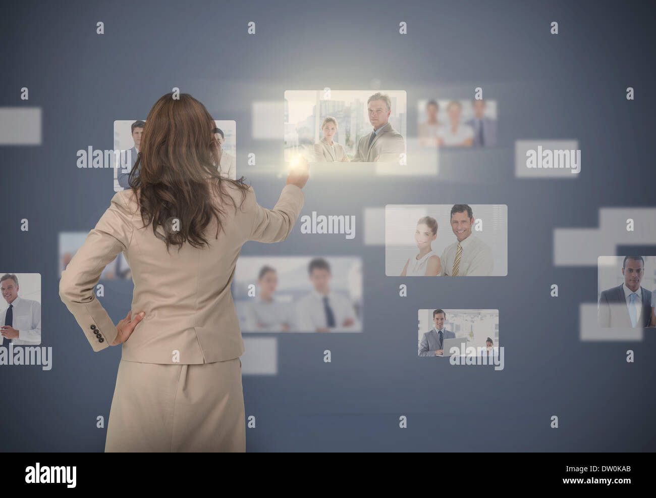 Businesswoman selecting digital interface - Stock Image