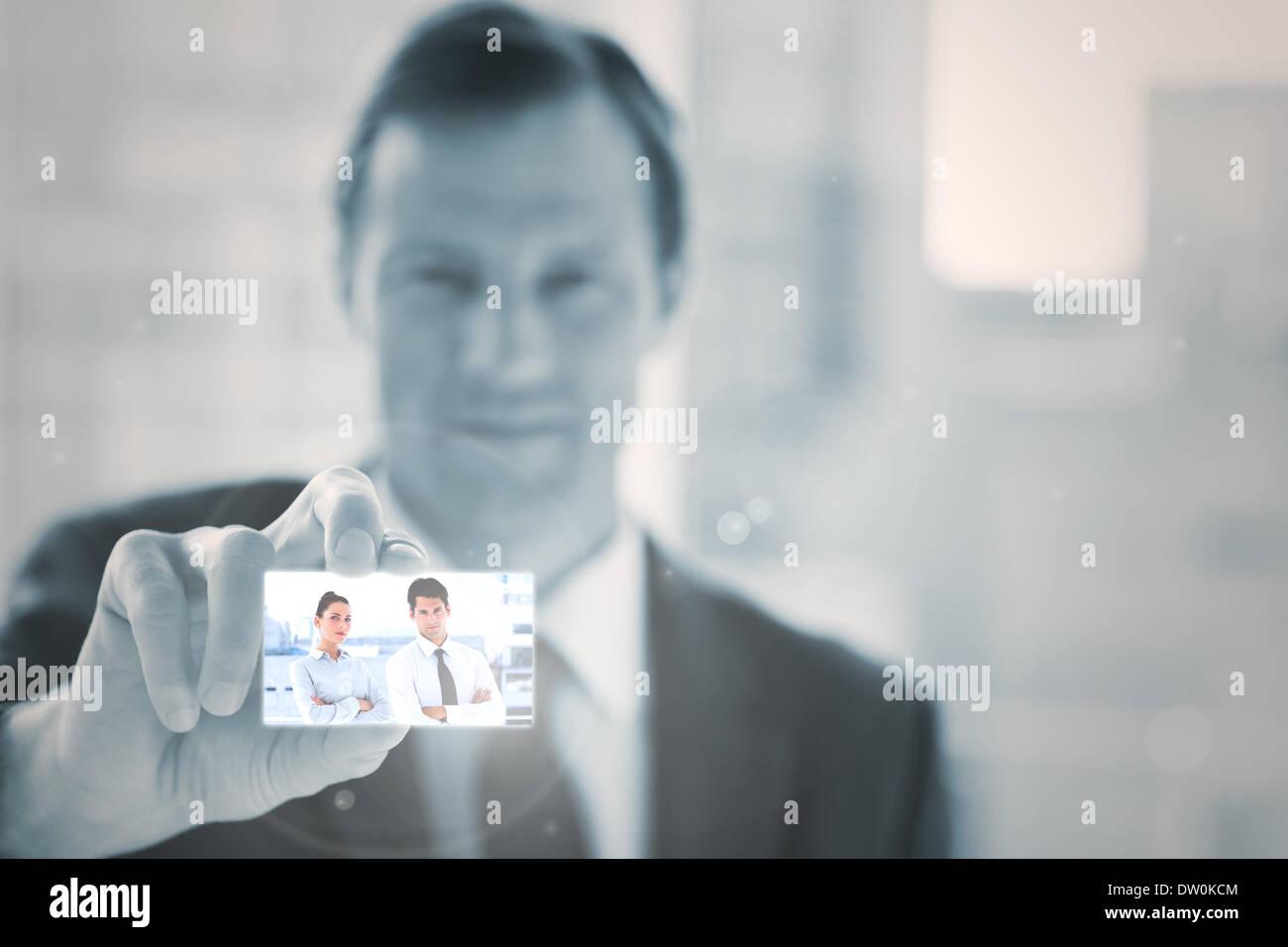 Businessman presenting digital interface Stock Photo