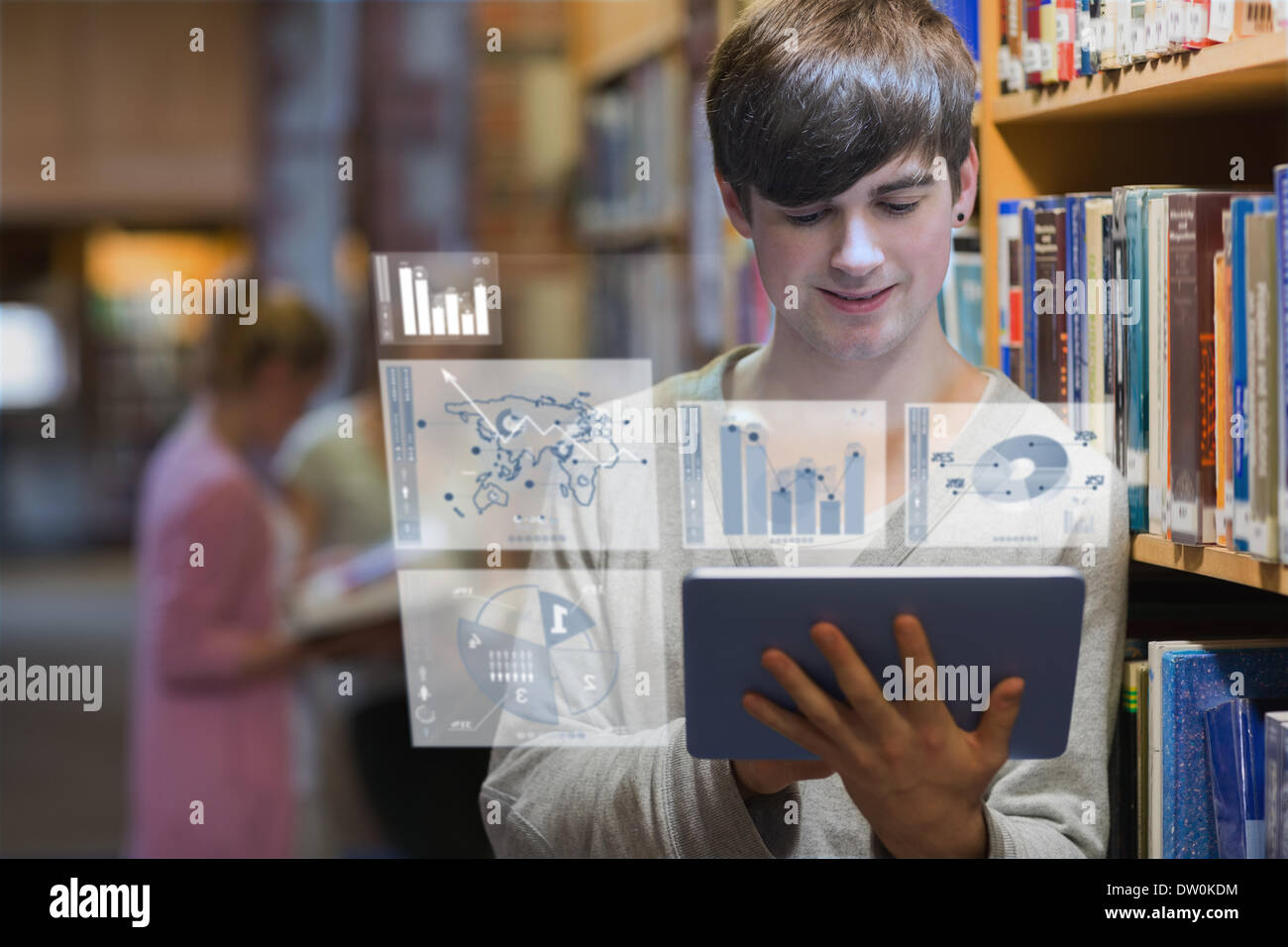 Young man studying on his futuristic tablet Stock Photo