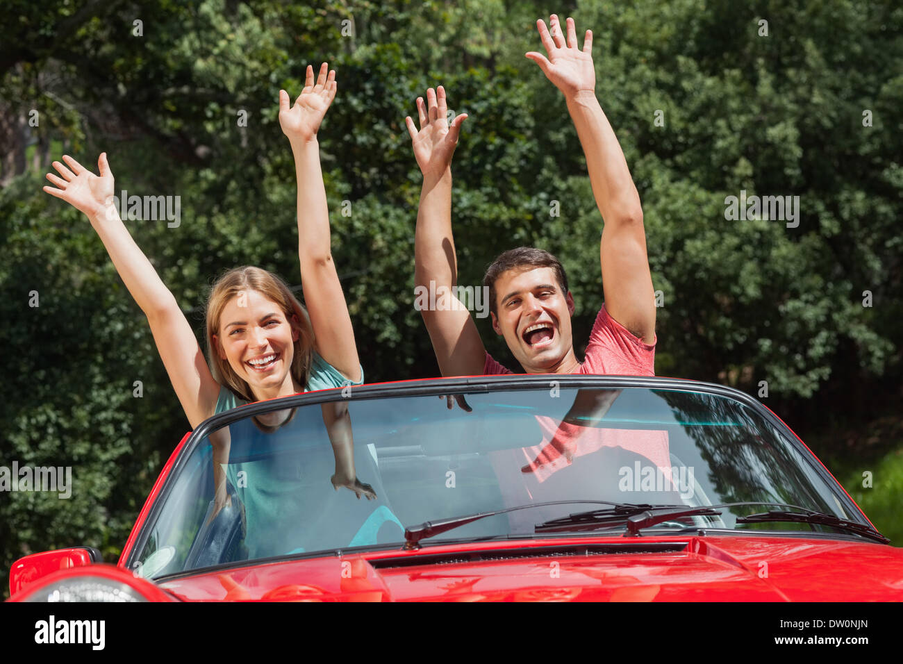 Happy couple having fun in their cabriolet Stock Photo