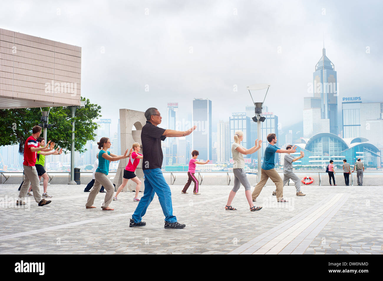 Tai Chi Public Exercising in early morning in Hong Kong. - Stock Image