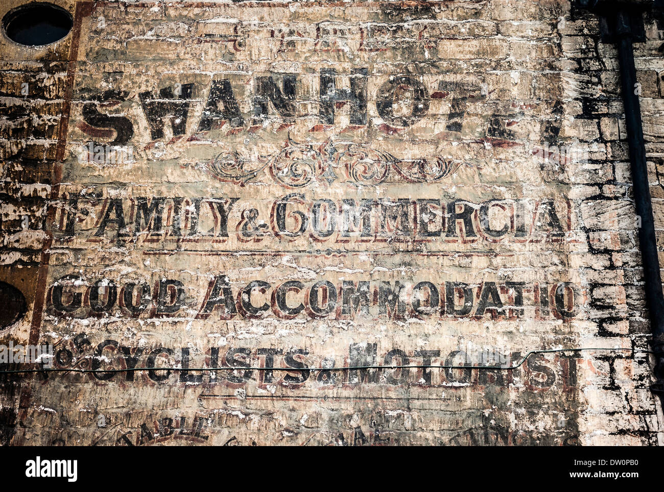 Old historical wall signs advertising services of the Swan Hotel in Bradford on Avon in yesteryear Stock Photo