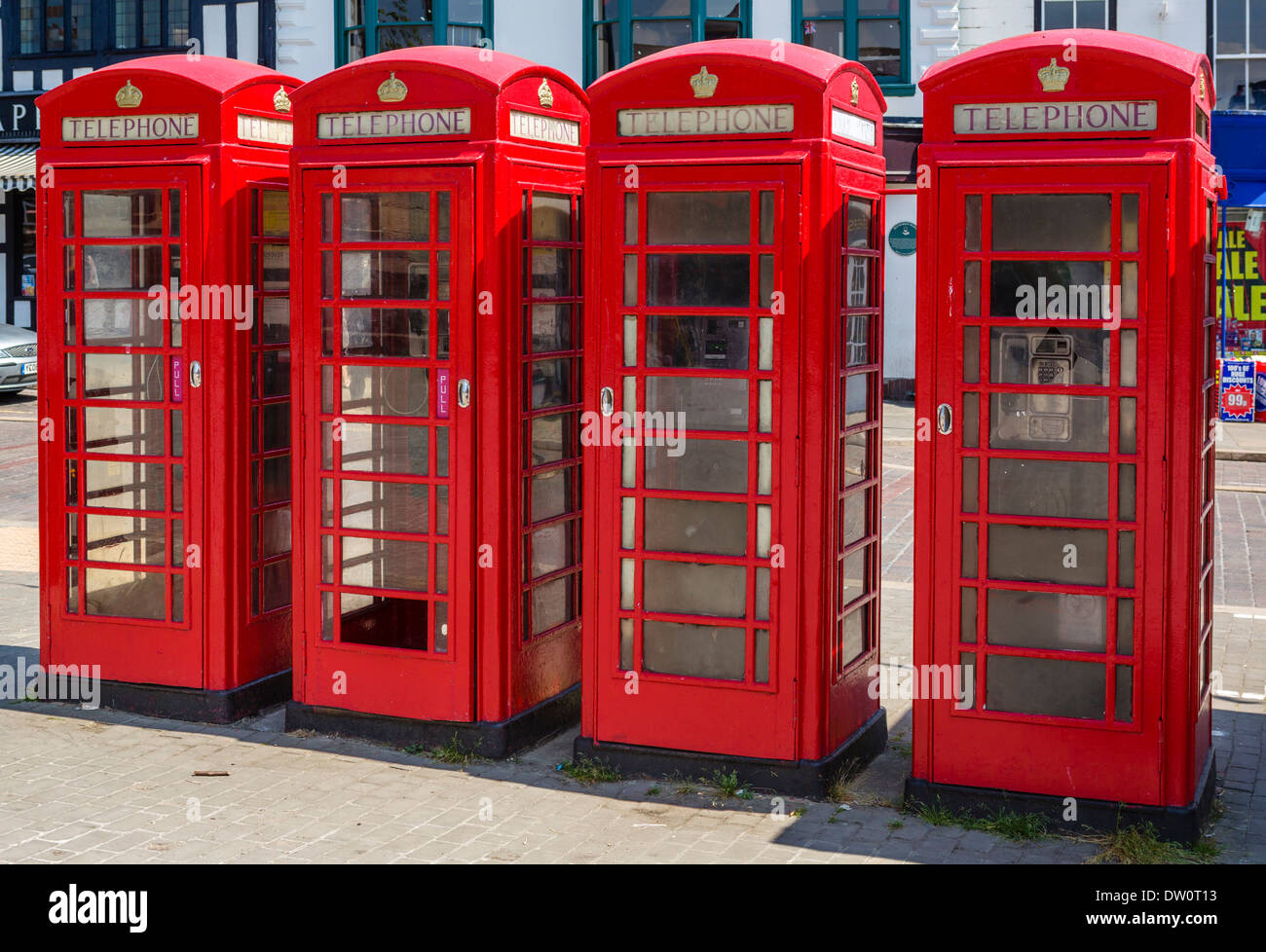 Row of traditional red telephone boxes in the historic old Market Place, Ripon, North Yorkshire, England, UK - Stock Image