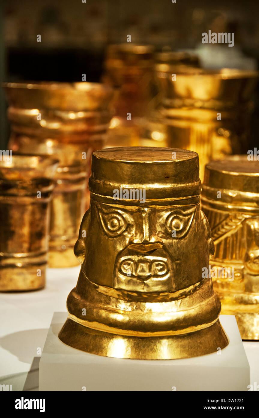 Gold beakers - Stock Image