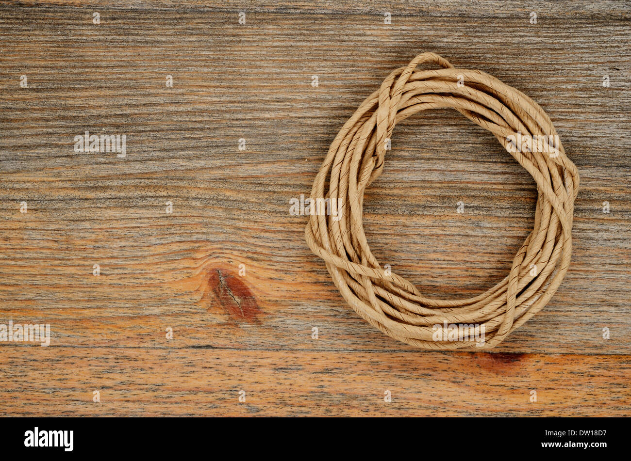 oval hank of packthread over wooden background - Stock Image