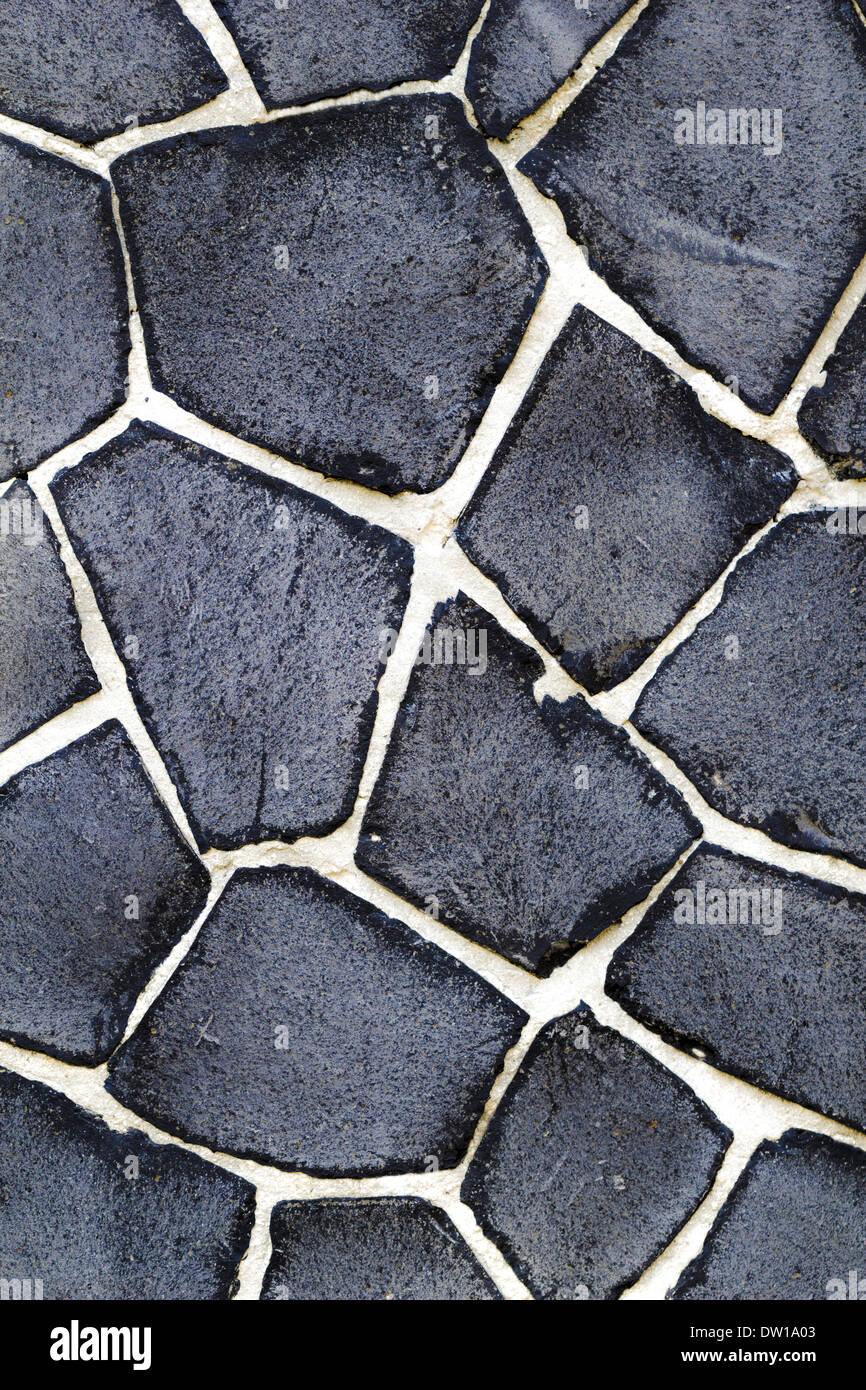 vintage black natural stone with white gaps - Stock Image