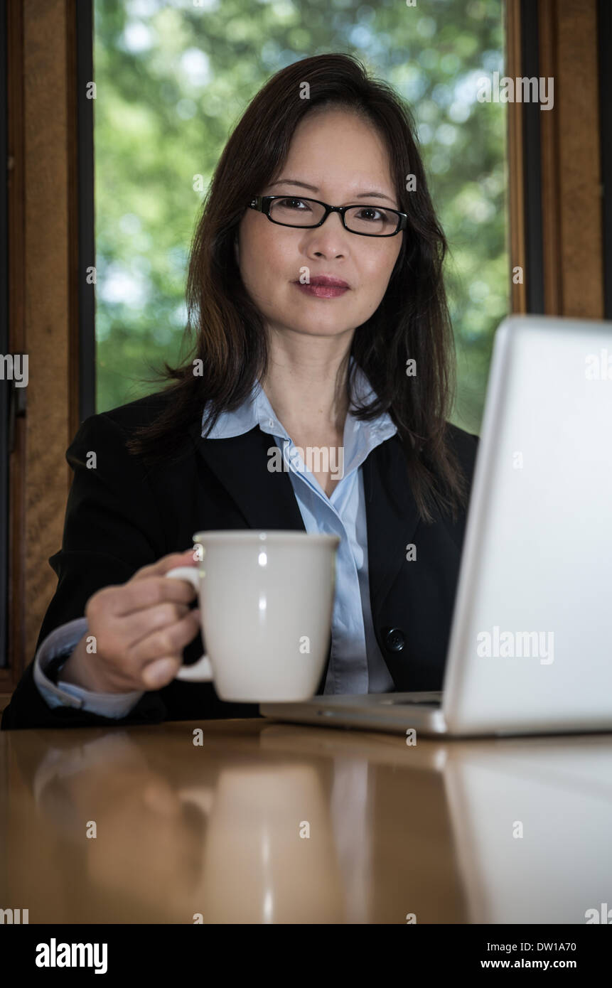 Woman with laptop and coffee Stock Photo