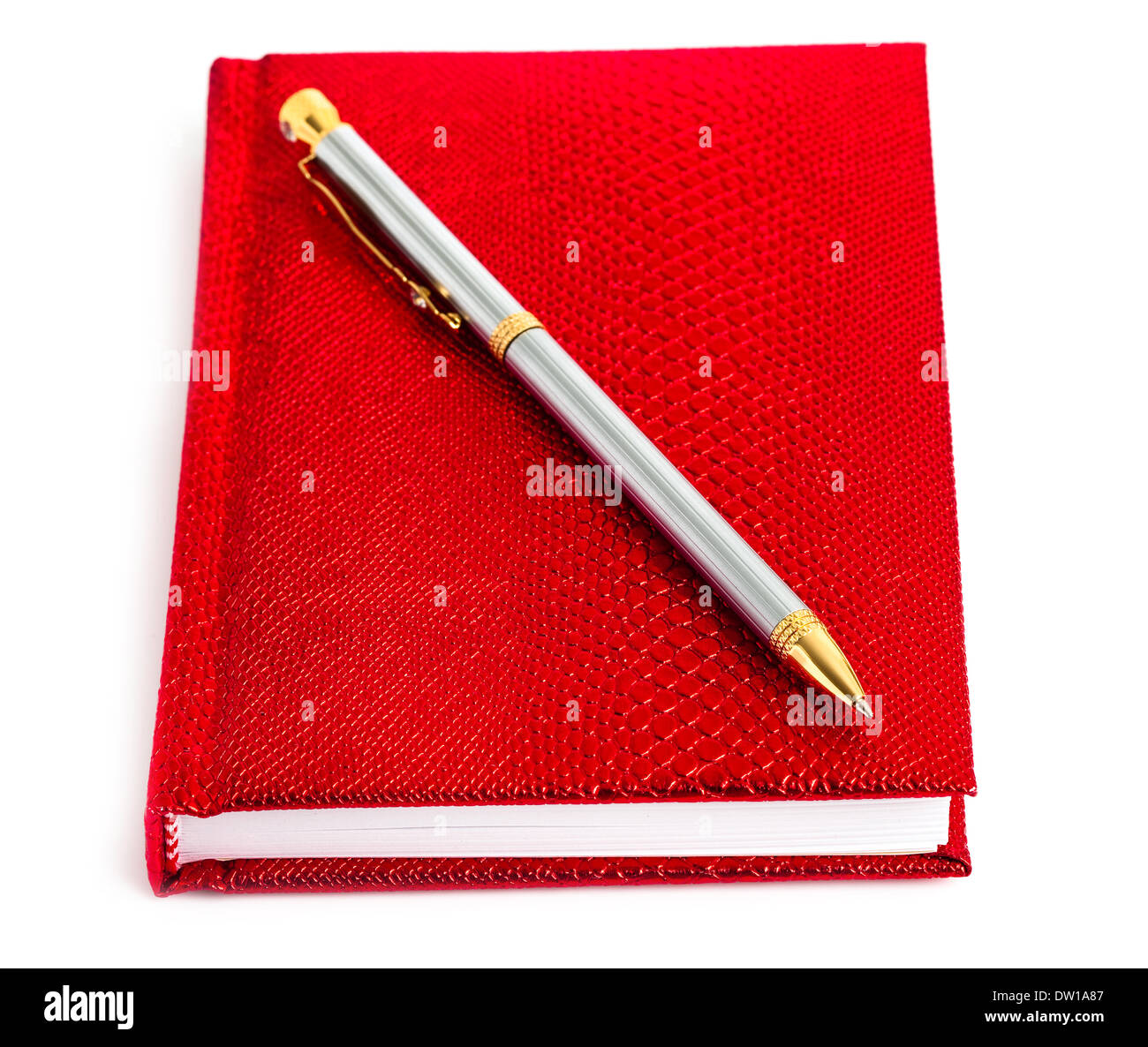 red notebook with silver pen - Stock Image