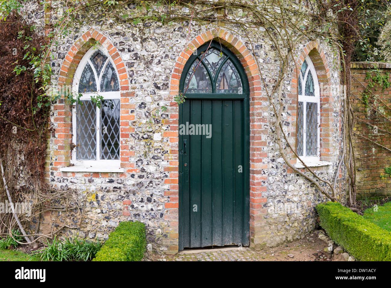 detail of brick arches around windows and door in round flint stock