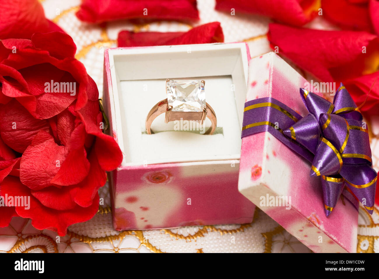 diamond ring in beautiful box with flowers - Stock Image