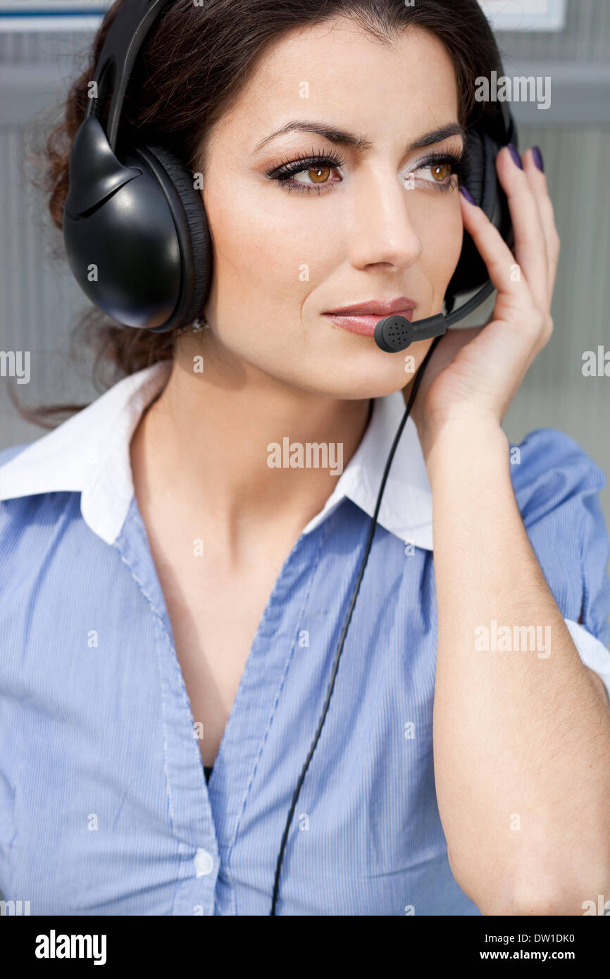 girl commentator with headset on the tribune - Stock Image